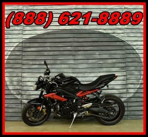 2014 Triumph Street Triple -- Black photo