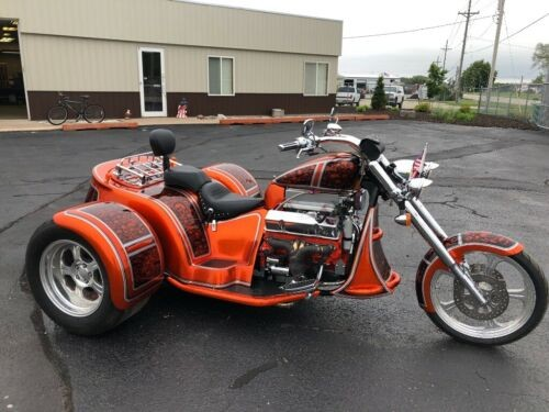 2007 Custom Built Motorcycles Other Orange metal flake with black skulls and silver trim for sale